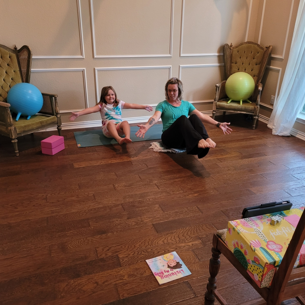 My daughter and I teaching boat pose to an online kids yoga class.